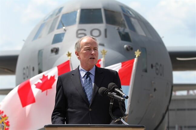 Rob Nicholson, Canada's minister of National Defence speaks on the tarmac at CFB Trenton in Trenton, Ont., on Thursday Aug, 7, 2014. THE CANADIAN PRESS/Lars Hagberg