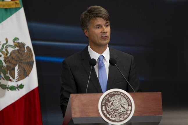 BMW board member Harald Kruger speaks at Los Pinos Presidential Residence in Mexico City, Thursday, July 3, 2014. Germany's BMW announced Thursday it will invest $1 billion to build a new luxury car factory in northern Mexican state of San Luis Potosi, that will start production in 2019. (AP Photo/Moises Castillo)