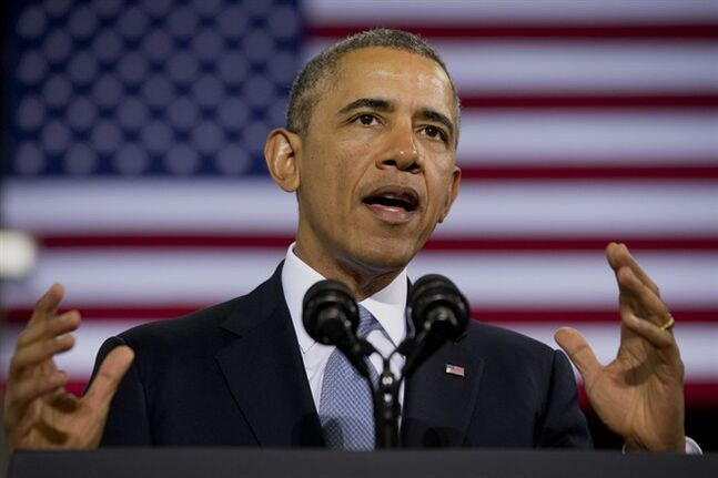 President Barack Obama speaks about how having a fuel-efficient truck fleet can boost the economy and help combat climate change, Tuesday, Feb. 18, 2014, at the Safeway Distribution Center in Upper Marlboro, Md. (AP Photo/Jacquelyn Martin)