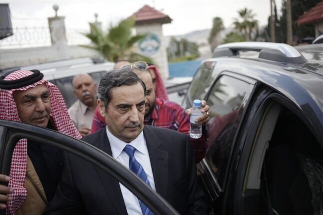 Fawaz al-Etan, the Jordanian ambassador in Libya, right, gets into his car upon his arrival to Marka Military Airport, in Amman, Jordan, Tuesday, May 13, 2014, after his release by his captors after he was abducted last month in Libya. Al-Etan was taken by gunmen from his vehicle in central Tripoli near the Jordanian Embassy on April 15. (AP Photo/Mohammad Hannon)