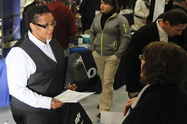 In this May 16, 2014 photo, Megan Lory, left, talks with Sandra Modena, Sales Manager at Trillium Staffing, at the annual veterans job fair aboard the LST in downtown Muskegon, Mich. Payroll processor ADP reports how many jobs private employers added in May on Wednesday, June 4, 2014. (AP Photo/The Muskegon Chronicle, Madelyn Hastings)