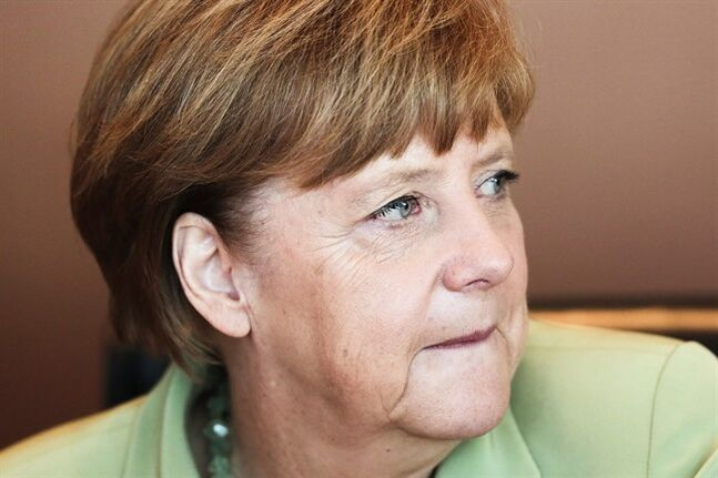 German Chancellor Angela Merkel leads the weekly cabinet meeting of her government at the chancellery in Berlin, Wednesday, June 18, 2014. (AP Photo/Markus Schreiber)