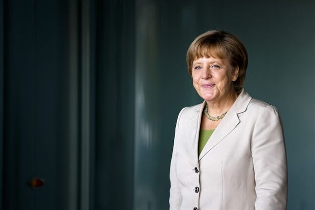 German Chancellor Angela Merkel waits for the arrival of the participants at the 'West Balkan Conference' at the chancellery in Berlin, Thursday, Aug. 28, 2014. Merkel invited to the conference to support the economic and political situation in the South-East European region. (AP Photo/Markus Schreiber, Pool)