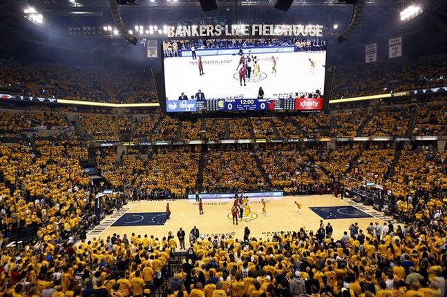Tipoff of Game 1 of the Eastern Conference finals NBA basketball playoff series between the Miami Heat and the Indiana Pacers, Sunday, May 18, 2014, in Indianapolis. (AP Photo/AJ Mast)