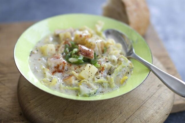 This Feb. 10, 2014 photo shows hearty potato, cabbage and smoked fish soup in Concord, N.H. (AP Photo/Matthew Mead)
