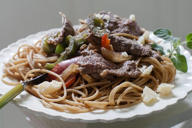 This June 9, 2014 photo shows easy steak and cheese pasta in Concord, N.H. (AP Photo/Matthew Mead)