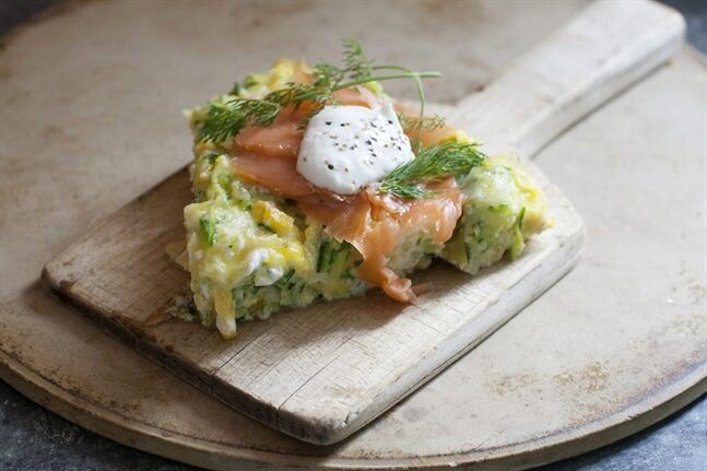 This June 9, 2014 photo shows an open faced corn and zucchini omelet with smoked salmon in Concord, N.H. (AP Photo/Matthew Mead)