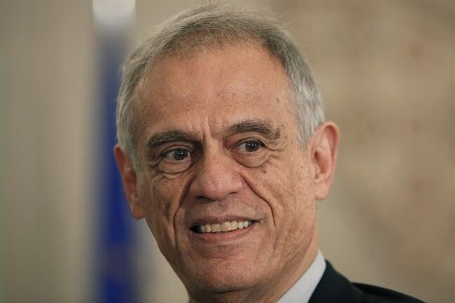 Cyprus Finance Minister Michalis Sarris, smiles during an oath-taking ceremony of the new cabinet at the presidential palace in capital Nicosia, Cyprus, Friday, March 1, 2013. Cyprus President Nicos Anastasiades told parliament that he wants to conclude a bailout agreement as soon as possible, but that doesn't mean accepting any write down. (AP Photo/Petros Karadjias)
