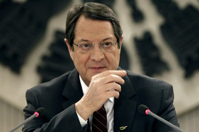 Cyprus President Nicos Anastasiades speaks during a nationally televised news conference at the Presidential Palace in Nicosia, Cyprus, Wednesday, Feb. 12, 2014. Anastasiades held the conference to defend a document he agreed with Turkish Cypriot leader Dervis Eroglu that paved the way for the resumption of negotiations a day earlier aimed at reunifying the war-divided island. Anastasiades faces strong pressure from critics who argue that the document contains the seeds of possible Turkish Cypriot statehood, which could unravel any peace accord. (AP Photo/Petros Karadjias)