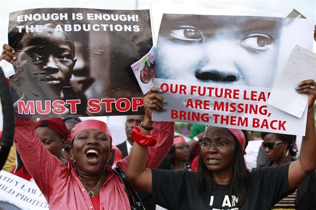 Women attend a demonstration calling on government to rescue kidnapped school girls of a government secondary school Chibok, in Lagos, Nigeria, Monday, May. 5, 2014. A leader of a protest march for 276 missing schoolgirls said that Nigeria's First Lady ordered her and another protest leader arrested Monday, expressed doubts there was any kidnapping and accused them of belonging to the Islamic insurgent group blamed for the abductions. Saratu Angus Ndirpaya of Chibok town said State Security Service agents drove her and protest leader Naomi Mutah Nyadar to a police station Monday. (AP Photo/ Sunday Alamba)