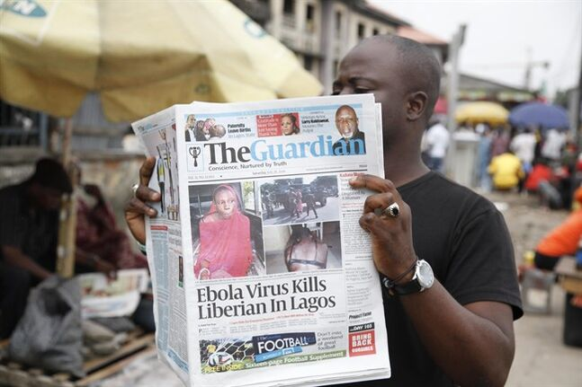 A man reads a newspaper on a Lagos street with the headline Ebola Virus kills Liberian in Lagos, Saturday, July 26, 2014. An Ebola outbreak that has left more than 660 people dead across West Africa has spread to the continent's most populous nation after a Liberian man with a high fever vomited aboard an airplane to Nigeria and then died there, officials said Friday. The 40-year-old man had recently lost his sister to Ebola in Liberia, health officials there said. It was not immediately clear how he managed to board a flight, but he was moved into an isolation ward upon arrival in Nigeria on Tuesday and died on Friday. (AP Photo/Sunday Alamba)