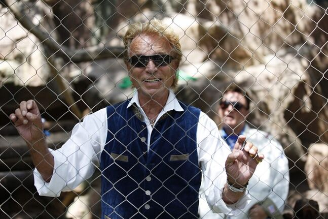 Siegfried Fischbacher speaks with the media during an event to welcome three white lion cubs to Siegfried & Roy's Secret Garden and Dolphin Habitat, Thursday, July 17, 2014, in Las Vegas. The three white lion cubs, born in South Africa, are scheduled to be available for public viewing Friday. (AP Photo/John Locher)