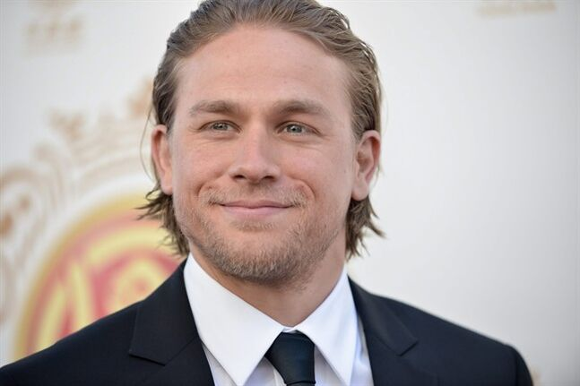 "FILE - In this June 1, 2014 file photo, Charlie Hunnam arrives at the Huading Film Awards in Los Angeles. The first trailer for the ""Fifty Shades of Grey"" movie will be out this week and Hunnam, the original Christian Grey, says he can't wait to see the finished product. (Photo by Richard Shotwell/Invision/AP)"