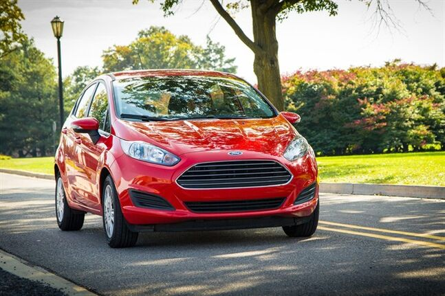 This undated photo provided by the Ford Motor Company shows the 2014 Ford Fiesta. Ford's smallest car in the United States, the Fiesta has a top fuel mileage rating from the federal government of 32 miles per gallon in city driving and 45 mpg on the highway. This combined 37-mpg mileage is for a Fiesta that's fitted with a 1-liter, three-cylinder, turbocharged, gasoline engine that generates 123 horsepower. (AP Photo/Ford Motor Company)