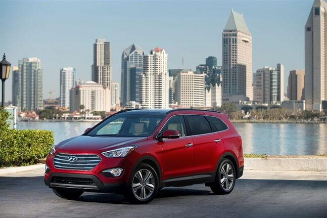 The 2014 Hyundai Santa Fe is seen in an undated photo provided by Hyundai. The 2014 Hyundai Santa Fe mid-size sport utility vehicle stands out from the crowd for its attractive styling, comfortable ride, value pricing, surprising standard features and warranty. (AP Photo/Hyundai)