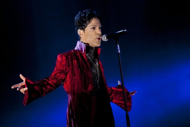 FILE - In this Aug. 9, 2011 file photo, U.S. musician Prince performs during his concert at the Sziget Festival on the Shipyard Island, northern Budapest, Hungary. The enigmatic star flew into London on Tuesday, Feb. 4, 2014, at the start of a still-evolving string of dates in support of forthcoming album