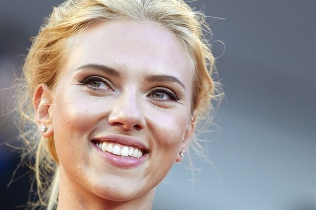 FILE - In this Sept. 3, 2013 file photo, actress Scarlett Johansson poses for photographers on the red carpet for the screening of the film