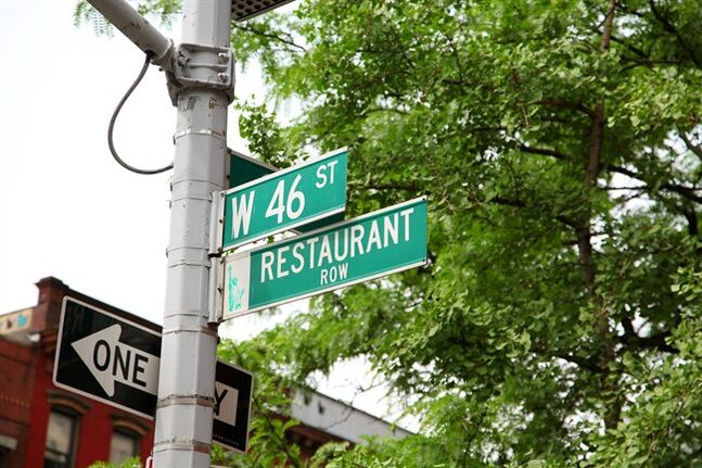 This May 21, 2014 photo shows a sign for Restaurant Row on 46th Street in New York. (AP Photo/Mark Kennedy)