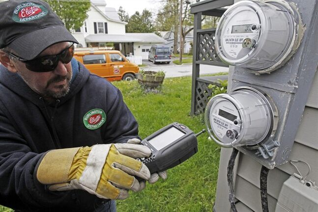 FILE - In this May 10, 2012 file photo, Mark Delbeck, of Burlington Electric, checks the radio frequency of a newly-installed