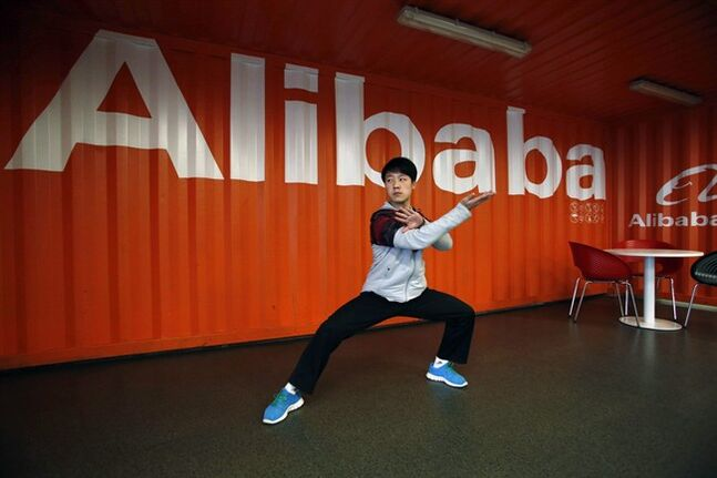 FILE - In this file photo taken Tuesday March 26, 2013, a worker performs shadow boxing during an open day at the e-commerce giant Alibaba Group office in Hangzhou in east China's Zhejiang province. As Alibaba gets ready for its blockbuster U.S. stock sale in the next few months, technology companies are getting slammed in the market. (AP Photo/File) CHINA OUT