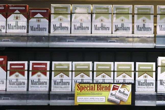 FILE - In this Wednesday, Oct. 23, 2013, file photo, Marlboro Gold and other Marlboro varieties of cigarettes are displayed in a Little Rock, Ark., store. Altria Group reports quarterly earnings on Thursday, Jan. 30, 2014. (AP Photo/Danny Johnston)