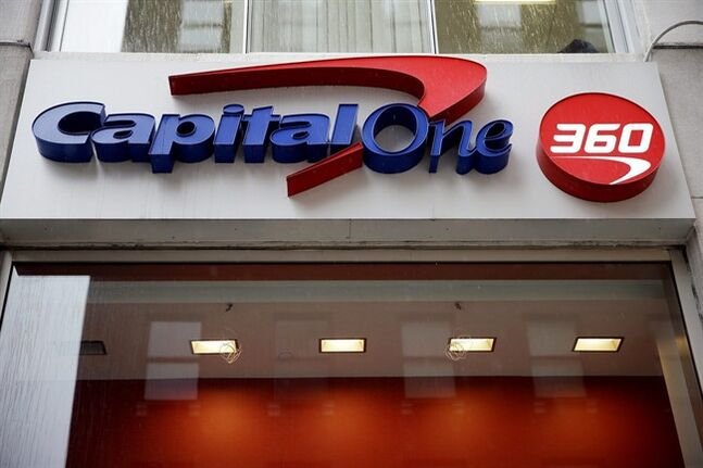 FILE - In this Jan. 14, 2014, file photo, a Capital One sign is displayed in Philadelphia. Capital One Financial Corp. reports quarterly financial results after the market close on Thursday, Jan. 16, 2014. (AP Photo/Matt Rourke, File)