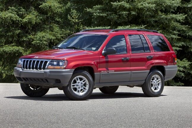 FILE - This undated file photo provided by Chrysler shows the 2002 Jeep Grand Cherokee. U.S. safety regulators are investigating whether a 2012 recall of 745,000 older-model Jeep Grand Cherokees and Libertys to fix air bags is working. The investigation affects Libertys from the 2002 and 2003 model years and Grand Cherokees from 2002 to 2004. (AP Photo/Chrysler, File)