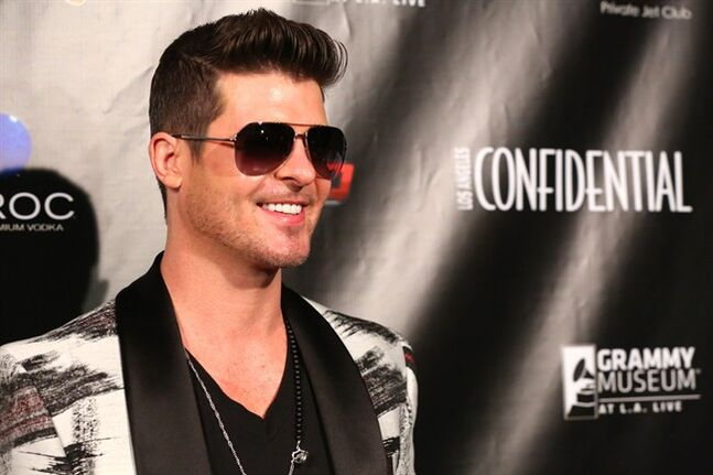 Robin Thicke at The Los Angeles Confidential magazine, CBS Radio and the GRAMMY Museum at L.A. LIVE celebrate The Grammys with 2014 three-time nominee Robin Thicke at the Conga Room, on Friday, Jan. 24, 2014 in Los Angeles. (Photo by Alexandra Wyman/Invision/AP)