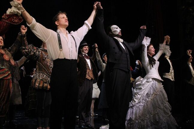 This May 12, 2014 photo released by The Publicity Office shows, front row from left, Jeremy Hays, Norm Lewis, and Sierra Boggess acknowledging applause on opening night for Lewis and Boggess after the Broadway production of