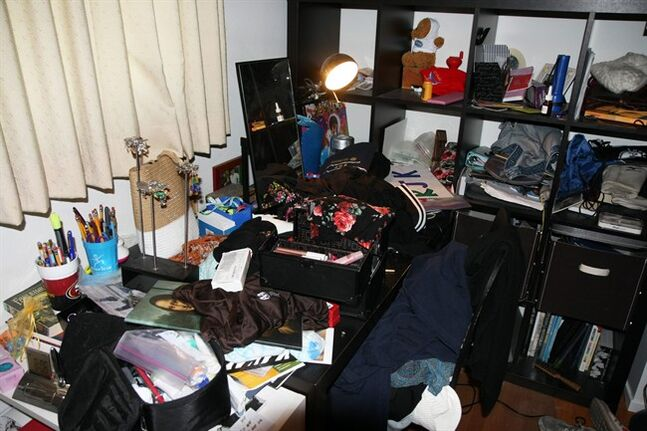 "This June 2014 photo courtesy of Michael & Melissa Kaufman shows the cluttered desk belonging to their ninth-grade daughter, Rebekah. Although the Kaufmans bought Rebekah the desk so she would have a place to study, she instead uses it as ""a repository for the four outfits she tried on earlier that day and rejected,"" Melissa says. Rebekah prefers doing homework on her bed. (AP Photo/Michael Kaufman)"