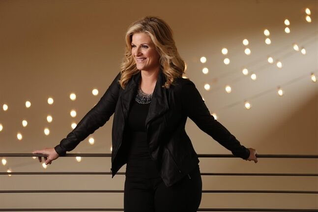 This Aug. 18, 2014 photo shows country singer Trisha Yearwood in Nashville, Tenn. Yearwood announced Tuesday, Aug. 19, she's releasing new music _ a hits package with six new songs called