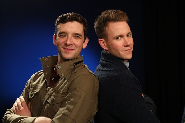 This Wednesday, Feb. 19, 2014 photo shows actors Michael Urie, left, and Christopher J. Hanke in New York. Urie will kick off a mini international tour with Jonathan Tolins' utterly charming and often wacky one-man show