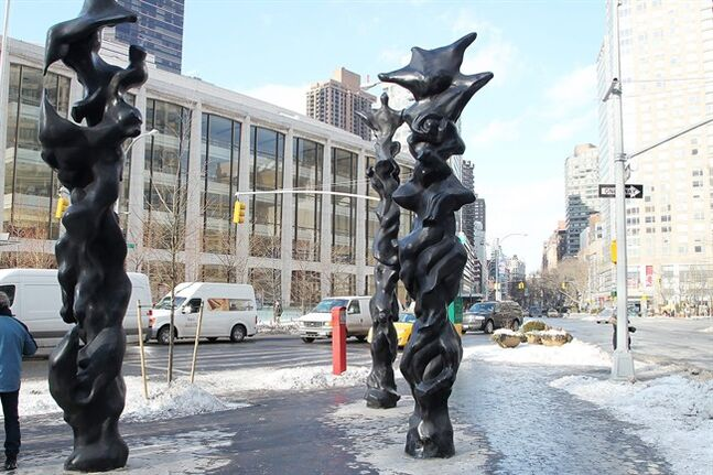 This image released by Starpix shows three black bronze totem sculptures by musician-artist Herb Alpert on display at Dante Park on west 64th Street and Broadway,Thursday, Jan 23, 2014 in New York. The sculptures will be on display until April 15. (AP Photo/Starpix, Dave Allocca)