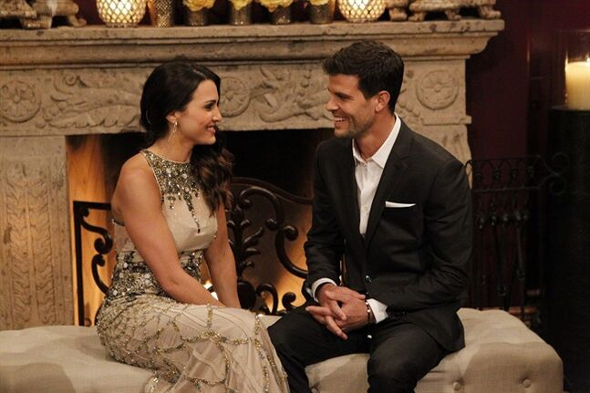 This image released by ABC shows Andi Dorfman, left, and Eric Hill on the premiere episode of