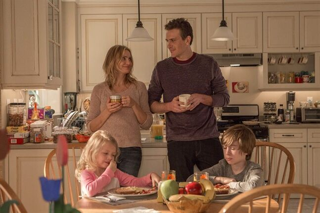 This image released by Sony Pictures shows Cameron Diaz, standing left, Jason Segel, standing right, and Giselle Eisenberg, seated left, and Sebastian Thomas in a scene from