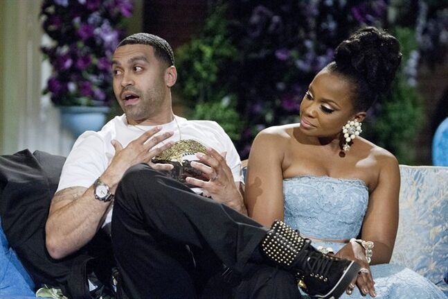This 2014 image released by Bravo shows Apollo Nida, left, and his wife Phaedra Parks, cast members on