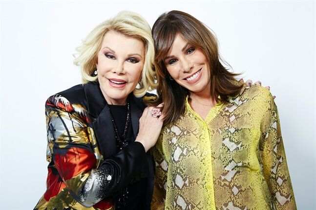 This Feb. 21, 2013 photo shows comedian Joan Rivers, left, and her daughter Melissa Rivers in New York. Joan leads a panel on