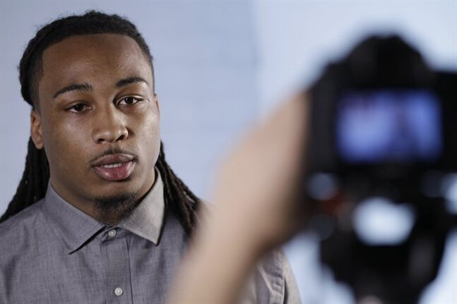This May 6, 2014 photo shows NFL Draft prospect Calvin Pryor, a safety from Louisville, responding to questions during an interview at the 5th Annual NFL Pre-Draft Gifting & Style Suite at the Sean John show room in New York. Pryor is among dozens of prospects on the National Football League's annual draft, with 32 players per round and seven rounds, beginning Thursday night at Radio City. (AP Photo/Frank Franklin II)