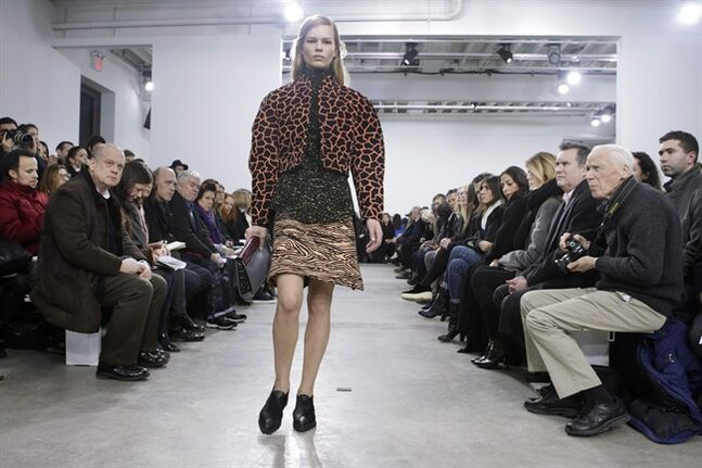 A model walks the runway during the showing of the Proenza Schouler Fall 2014 collection at Fashion Week in New York, Wednesday, Feb. 12, 2014. (AP Photo/Kathy Willens)
