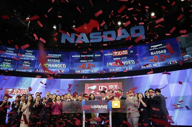 Employees and guests of JD.com celebrate the IPO for the company at the Nasdaq MarketSite, Thursday, May 22, 2014 in New York. JD.com, China's No. 2 e-commerce service, is headquartered in Beijing. (AP Photo/Mark Lennihan)