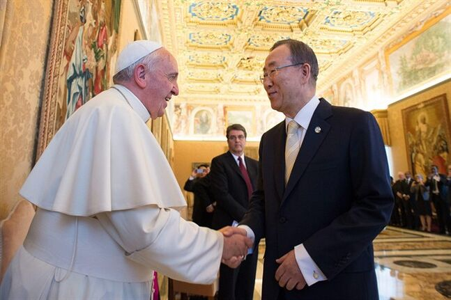 In this photo provided by the Vatican newspaper L'Osservatore Romano, Pope Francis greets U.N. Secretary-General Ban Ki-moon at the Vatican, Friday, May 9, 2014. Pope Francis called Friday for governments to redistribute wealth to the poor in a new spirit of generosity to help curb the