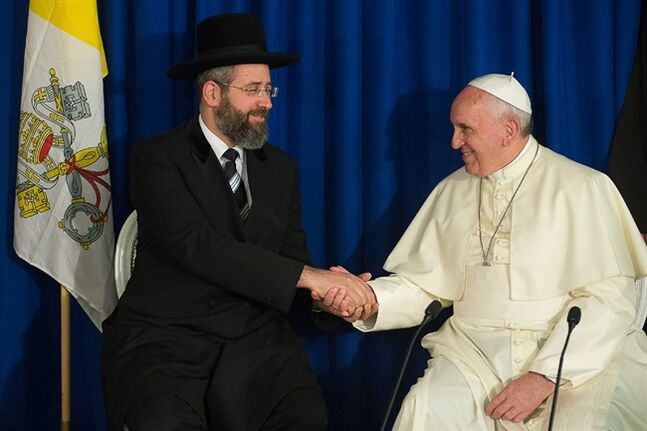 In this photo provided by the Vatican newspaper L'Osservatore Romano, Pope Francis shakes hands Ashkenazi Chief Rabbi David Lau, at the Heichal Shlomo center in Jerusalem, Israel, Monday, May 26, 2014. (AP Photo/L'Osservatore Romano, ho)