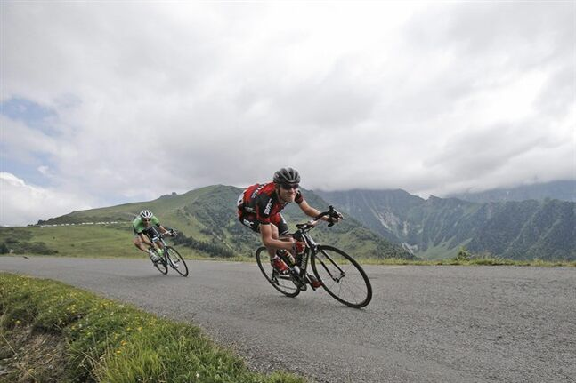 Tejay van Garderen of the U.S., right, and Netherlands' Laurens ten Dam, left, speed down Val Louron Azet pass during the seventeenth stage of the Tour de France cycling race over 124.5 kilometers (77.4 miles) with start in Saint-Gaudens and finish in Saint-Lary, France, Wednesday, July 23, 2014. (AP Photo/Christophe Ena)