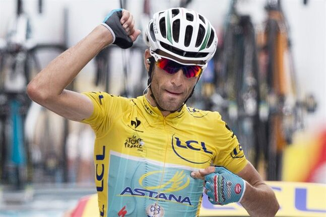 Italy's Vincenzo Nibali crosses the finish line to win the eighteenth stage of the Tour de France cycling race over 145.5 kilometers (90.4 miles) with start in Pau and finish in Hautacam, Pyrenees region, France, Thursday, July 24, 2014. (AP Photo/Peter Dejong)