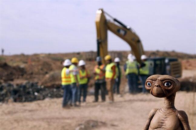 An E.T. doll is seen while construction workers prepare to dig into a landfill in Alamogordo, N.M., Saturday, April 26, 2014. Producers of a documentary are digging in the landfill in search of millions of cartridges of the Atari 'E.T. the Extra-Terrestrial' game that has been called the worst game in the history of videogaming. A New York Times article from 1983 reported that Atari cartridges of