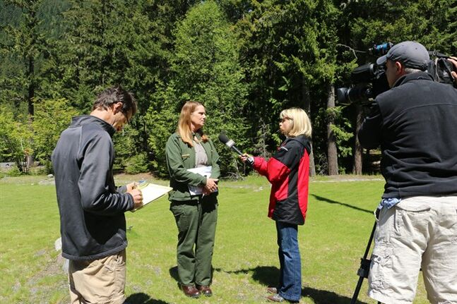Mount Rainier National Park spokeswoman Patti Wold talks to the media outside of the park's headquarters on Sunday, June 1, 2014. Officials said that there are no immediate plans to recover the bodies of six climbers who likely fell thousands of feet to their deaths in the worst alpine accident on the mountain in decades. (AP Photo/Rachel La Corte)