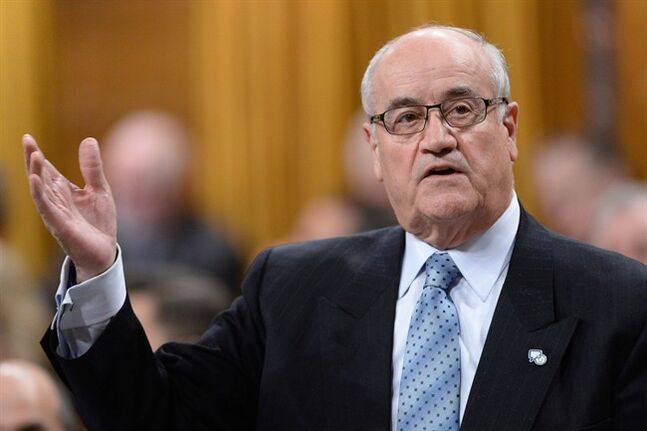 Veterans Affairs Minister Julian Fantino answers a question during question period in the House of Commons in Ottawa, Wednesday, January 29, 2014. THE CANADIAN PRESS/Sean Kilpatrick