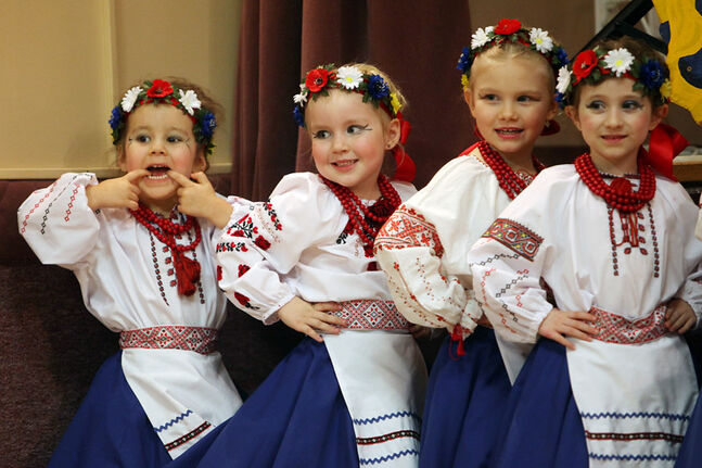 One young dancer pulls a face as the beginner dancers with the Troyanda School of Ukrainian Dance prepare to perform at the Ukrainian Pavilion at last year's Winter Festival.