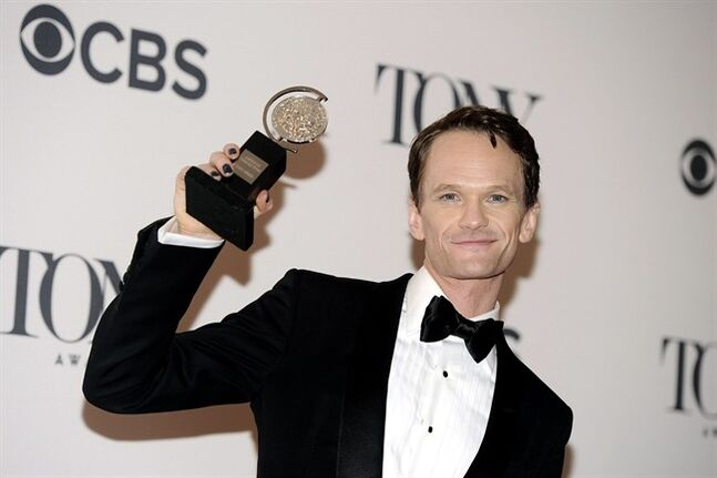 Neil Patrick Harris poses with his award for best performance by an actor in a leading role in a musical for his role in