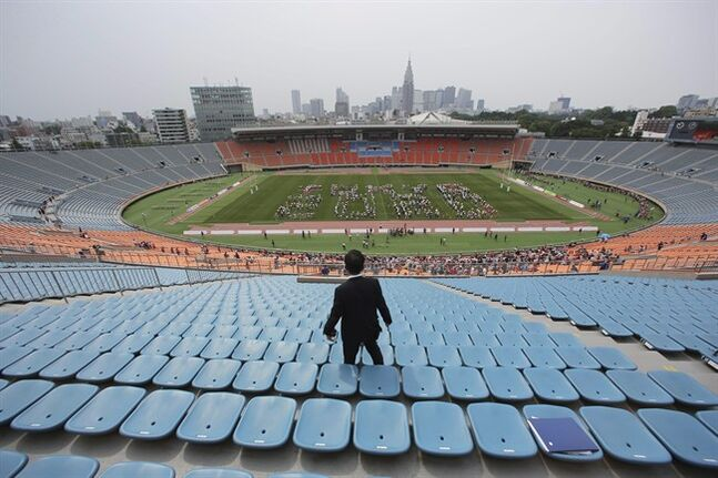"In this Sunday, May 25, 2014 photo, volunteers form the words ""Tokyo 2020"